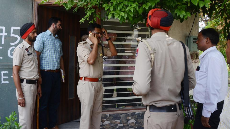Police officials investigating at the crime spot at Dugri Phase 2 in Ludhiana on Friday.
