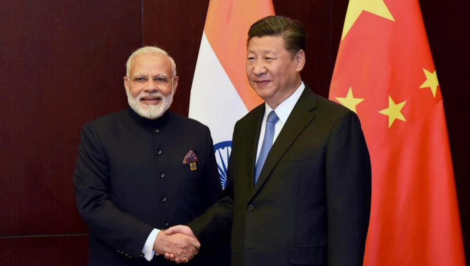 Prime Minister Narendra Modi and Chinese President Xi Jinping on the sidelines of the SCO Summit in Astana, Kazakhstan.
