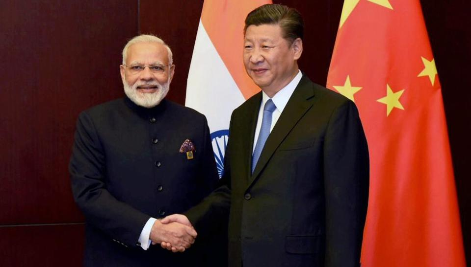 Prime Minister Narendra Modi with Chinese President Xi Jinping on the sidelines of the SCO Summit in Astana, Kazakhstan, on Friday.
