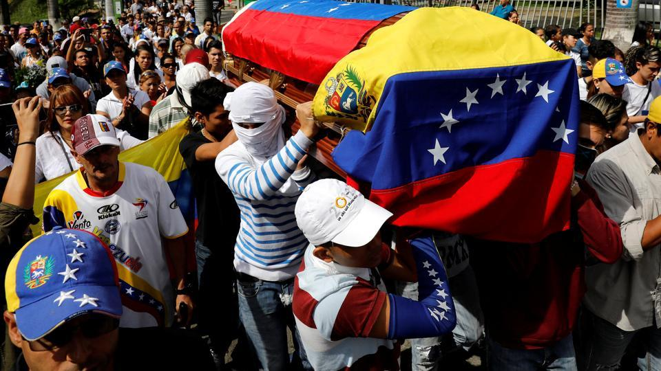 Mourners carry the coffin of Neomar Lander during his funeral in Guarenas, Venezuela.  (Carlos Garcia Rawlins/REUTERS)