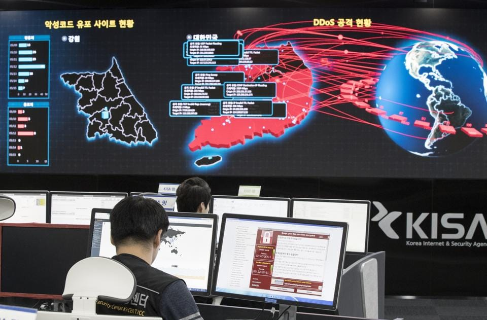 Employees watch electronic boards to monitor possible ransomware cyberattacks at the Korea Internet and Security Agency in Seoul, May 15. The WannaCry cyberattack was the biggest in history.