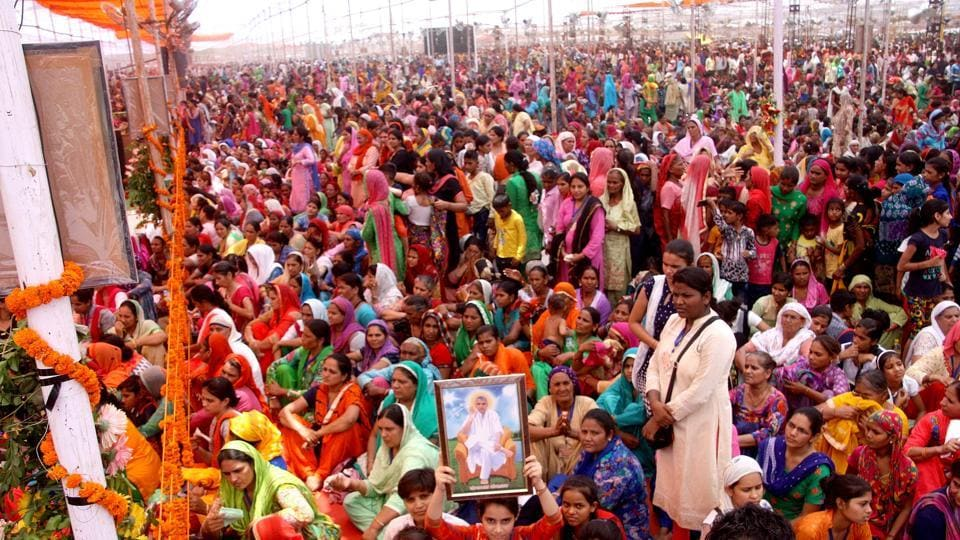 Devotees of self styled godman Rampal come to pay their respects to him on Kabir Jayanti in Rohtak on Friday.
