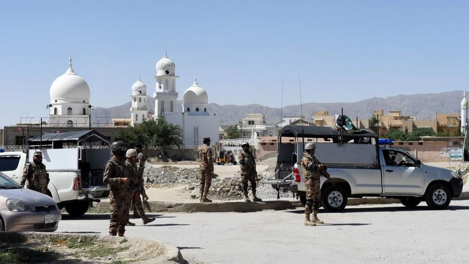 Pakistani soldiers stand guard at the site where a Chinese couple was kidnapped in the neighbourhood of Jinnah town in Quetta on May 24.