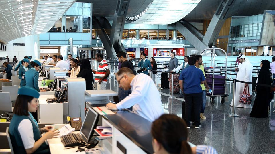 Passengers check-in at the Hamad International Airport in Doha on June 7, 2017. A ban on Qatari flights imposed by Saudi Arabia and its allies took effect as first efforts were made to resolve the biggest feud to hit the Arab world in years.