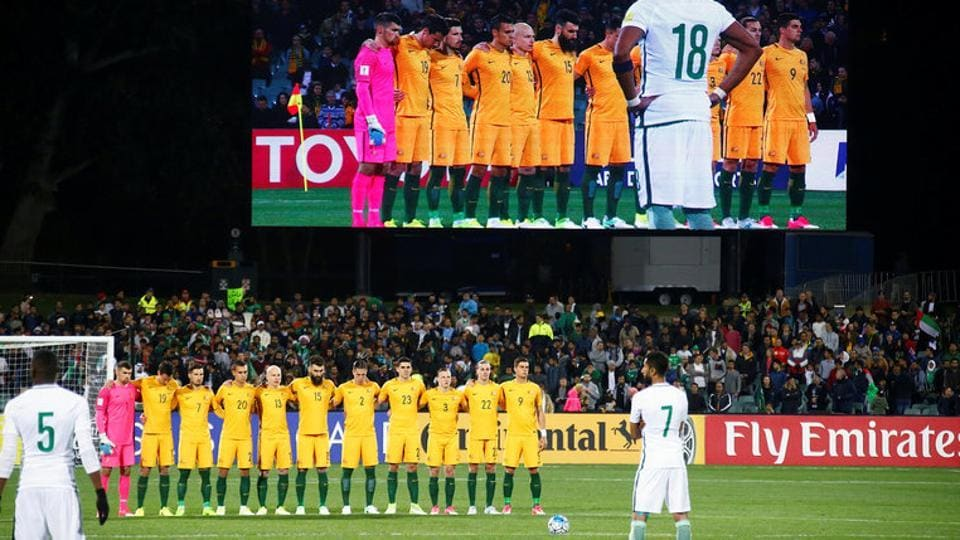 The Australian football team stand together as they observe a minute's silence for victims of the London attacks, in which two Australians died, even as Saudi Arabia football players refused to take part in the show of respect.