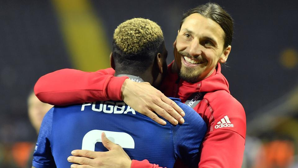United's Zlatan Ibrahimovic, right, celebrates with teammate Paul Pogba after winning the Europa League final.