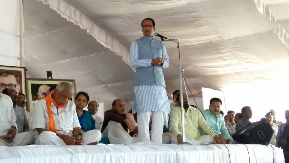 Madhya Pradesh chief minister Shivraj Singh Chouhan speaks during his indefinite fast at the BHEL Dussehra ground in Bhopal on Saturday.