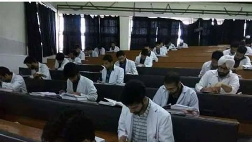 The pictures of the medical students wearing white gowns immersed in books while going through the assessment vent viral with many users misconstruing it as mass copying.