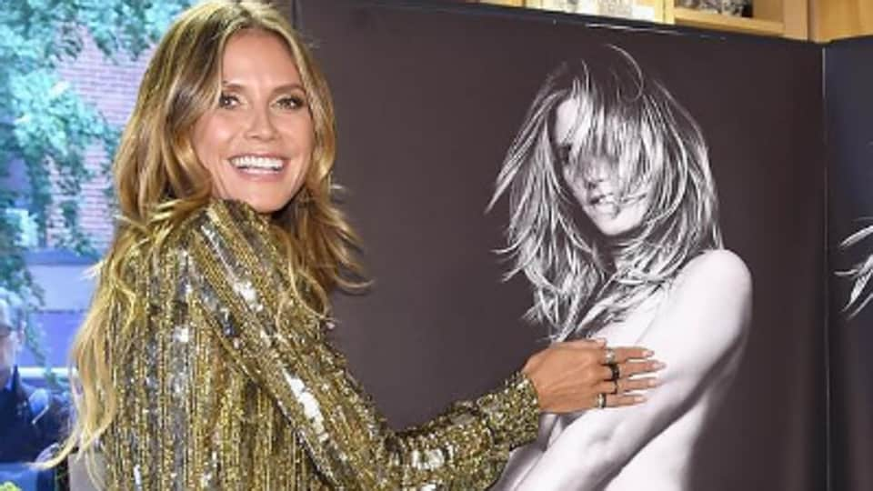 Heidi Klum, 44, believes staying naked makes her a 'hippie at heart'.