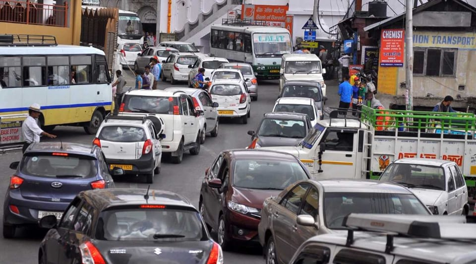 A traffic jam near the old bus stand, located a level below the Mall Road in the heart of Shimla, on Friday. This is one of the choking points in the town that is hit because of road repair amid busy traffic.