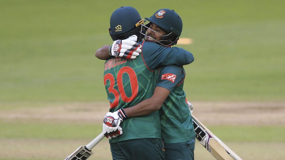 Bangladesh's Mosaddek Hossain (R) and Mahmudullah celebrate after winning the ICC Champions Trophy Group A match against New Zealand at Sophia Gardens, Cardiff on Friday.