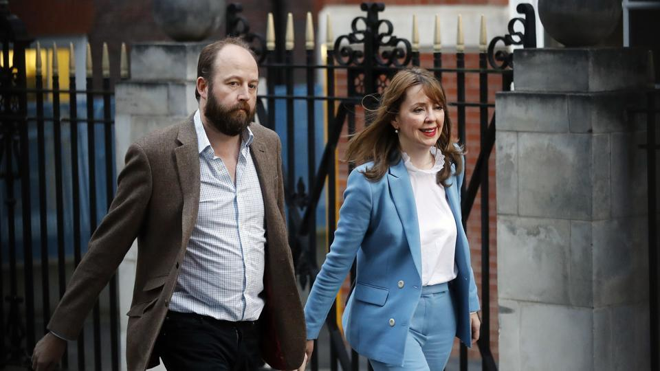 In this Friday, June 9, 2017 file photo, Prime Minister Theresa May's chief of staff Nick Timothy, left, and Joint-chief of staff Fiona Hill leave Conservative Party headquarters in London. British Prime Minister Theresa May's two chiefs of staff have resigned in the wake of the Conservative Party's disastrous election result.