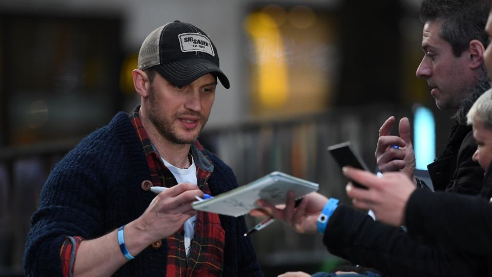 British actor Tom Hardy signs autographs for fans upon arrival at the world premiere of Alien: Covenant in London on May 4.