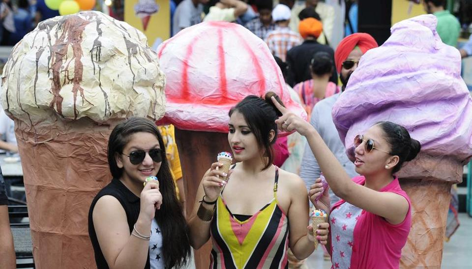Visitors at ice cream festival in Chandigarh's Sukhna Lake on Friday.
