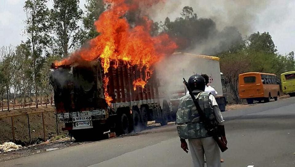 Farmers torch vehicles during a protest in Phanda near Bhopal on June 9.