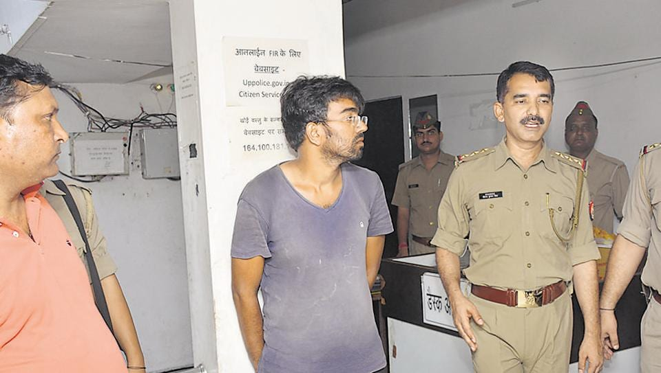 Anuj Tyagi alias Dabbu (in grey shirt) is said to suffer from schizophrenia. He had been absconding for almost a month before he was arrested from Ghaziabad on Saturday.