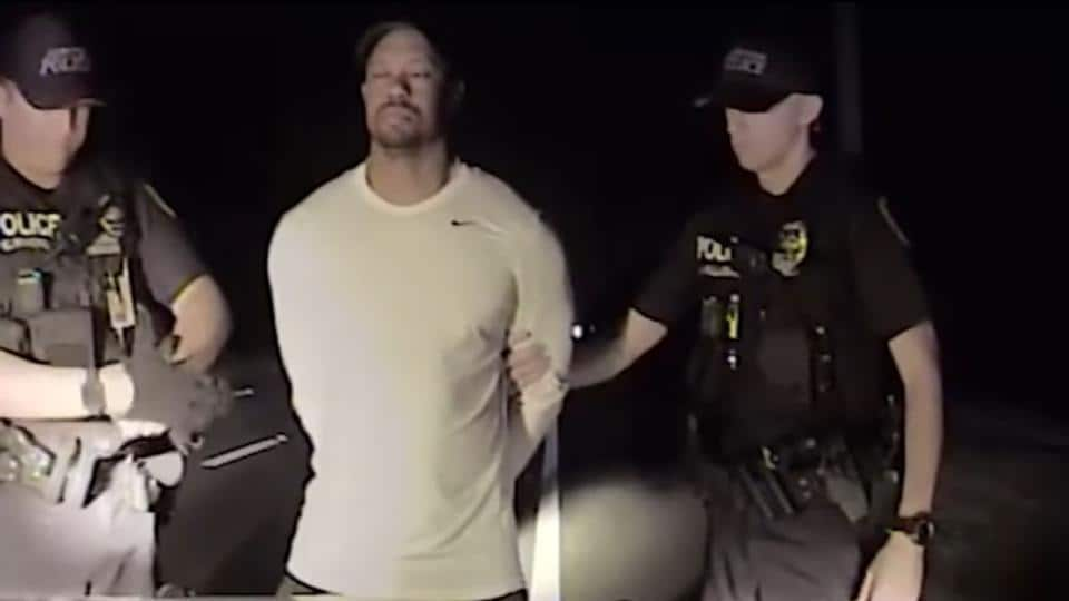 This still image from a dashcam video released by the Jupiter, Florida, Police Department on May 31 shows police offices arresting golfer Tiger Woods on May 29.