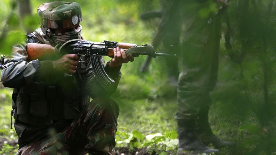 Soldiers take position during an operation against militants in Kashmir's Shopian district.