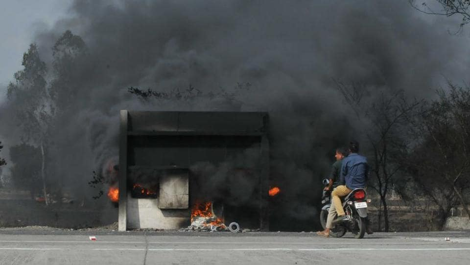 Smoke billows from a toll booth set on fire by the agitating farmers on the Mhow- Neemuch highway in Mandsaur, Madhya Pradesh on June 7.