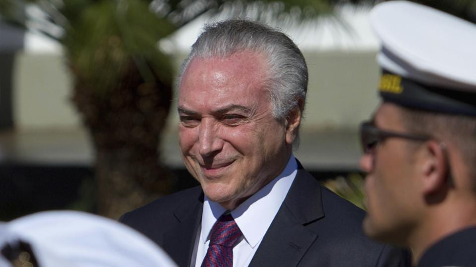 Brazil's top electoral court has decided to keep embattled President Michel Temer in office.