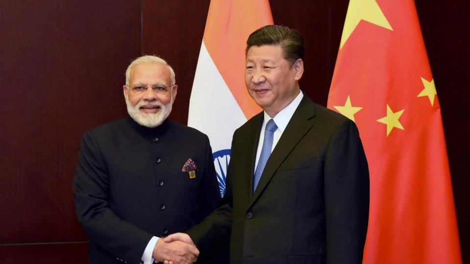 Prime Minister Narendra Modi and Chinese President Xi Jinping on the sidelines of the SCO Summit in Astana, Kazakhstan on Friday.