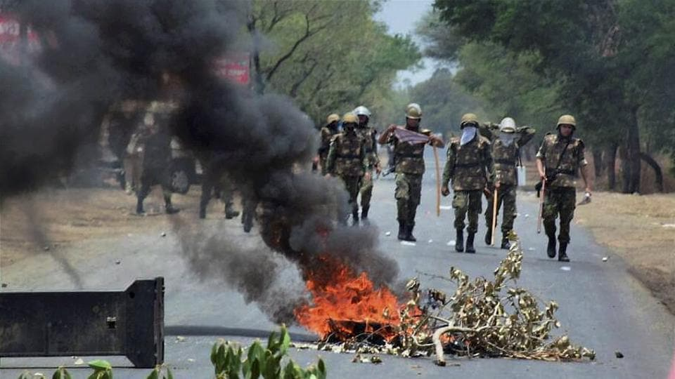 Security personnel patrol the Indore-Bhopal highway after a farmers protest  on Friday.