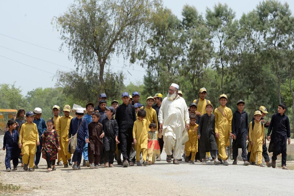 Gulzar Khan (centre) has 36 children from his three wives.