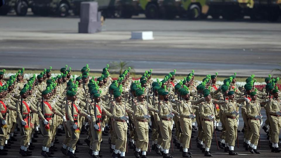 Pakistani army soldiers march past during a Pakistan Day military parade in Islamabad on March 23, 2017.