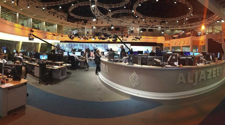 In this Thursday, June 8, 2017 photo, Al Jazeera staff work at their TV station in Doha, Qatar. The Arab news network Al-Jazeera has been thrust into the center of the story this week as Qatar came under virtual siege by its Gulf neighbours, pressuring it to shut down the TV channel that has infuriated them with its coverage for 20 years.