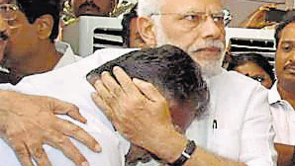 Prime Minister Narendra Modi consoles O Panneerselvam after paying his last respects to Tamil Nadu's former chief minister J Jayalalithaa at Rajaji Hall in Chennai on December 6, 2016.