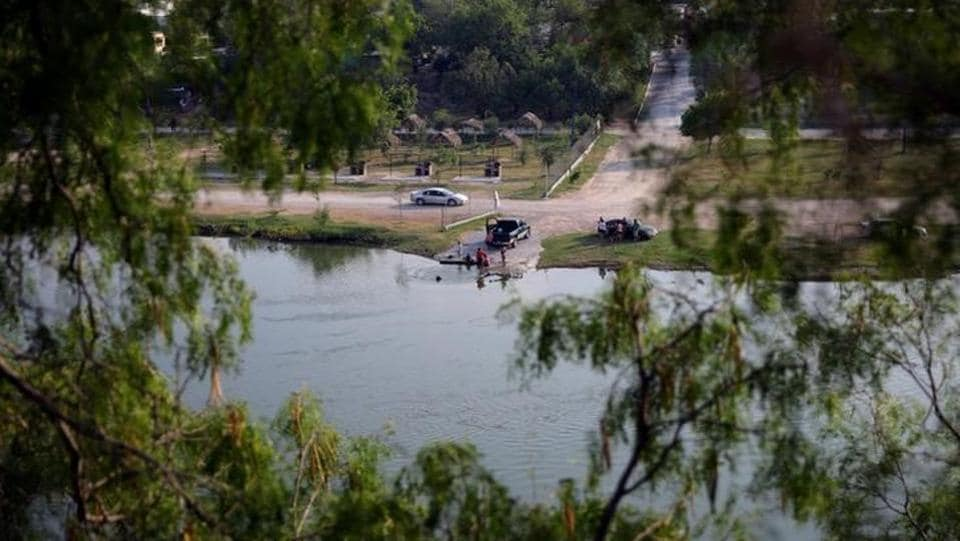 Local residents of Ciudad Miguel Aleman town are seen by the Rio Grande river at the border between United States and Mexico, in Roma, Texas. (REUTERS)