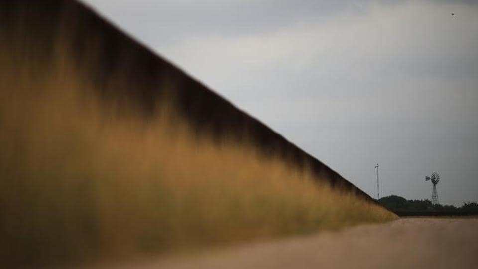 The US-Mexico border fence is seen in McAllen, Texas. (REUTERS)