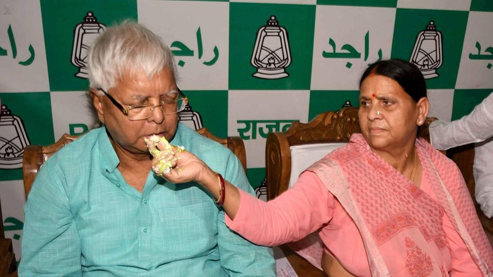 RJD leader Rabri Devi offers cake to her husband and RJD chief Lalu Prasad Yadav during his 70th birthday function in Patna on Sunday.