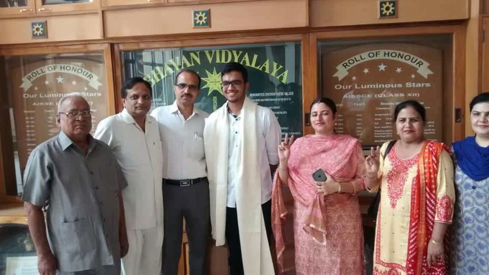 Sarvesh Mehtani with parents and his school staff in Bhawan Vidyalaya Panchkula.