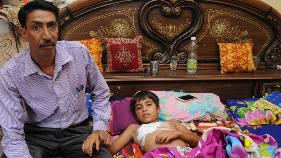 Victim Shiv Kumar with father, Subhash Chander, at his home in Nayagaon on Saturday.