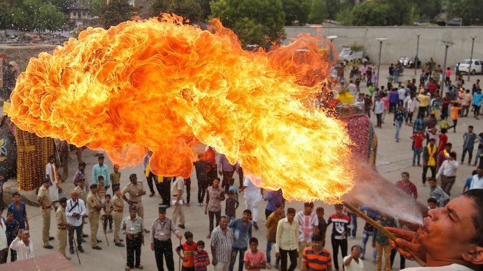 A Hindu devotee performs a stunt with fire during the Jal Yatra procession ahead of the annual Rath Yatra, or chariot procession, which will be held on June 25, in Ahmedabad, India. (Amit Dave  / REUTERS)