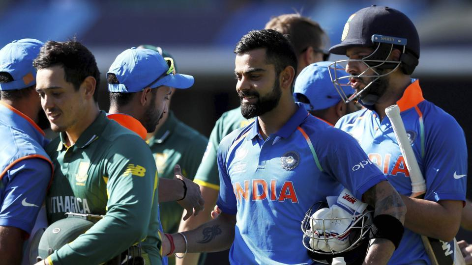 India's Virat Kohli, centre, and Yuvraj Singh after their eight-wicket win over South Africa in the ICC Champions Trophy.