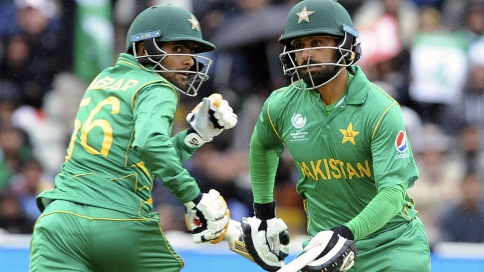 Pakistan's Babar Azam, left, and Pakistan's Mohammad Hafeez run between wickets during the ICC Champions Trophy.