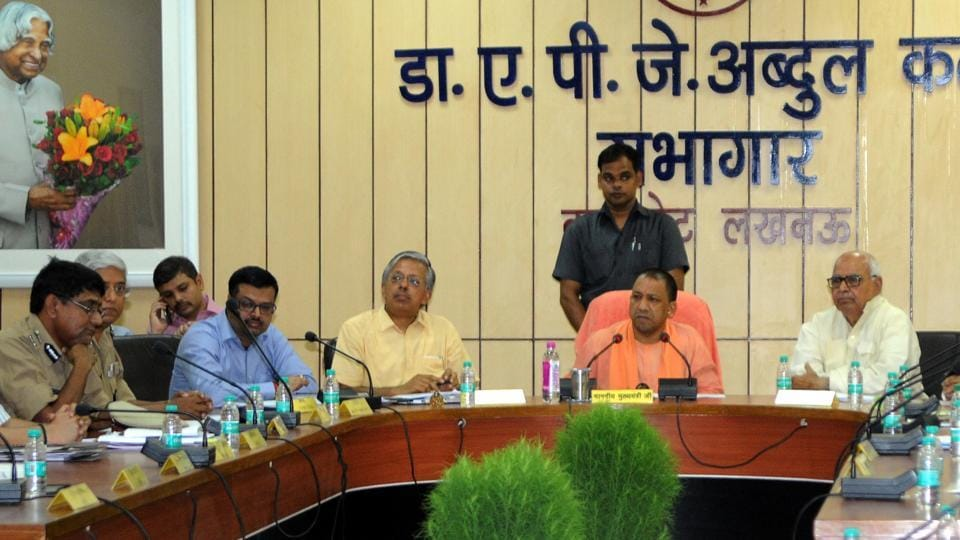 UP CM Yogi Adityanath conducting a meeting at the DM's office in Lucknow on Saturday.