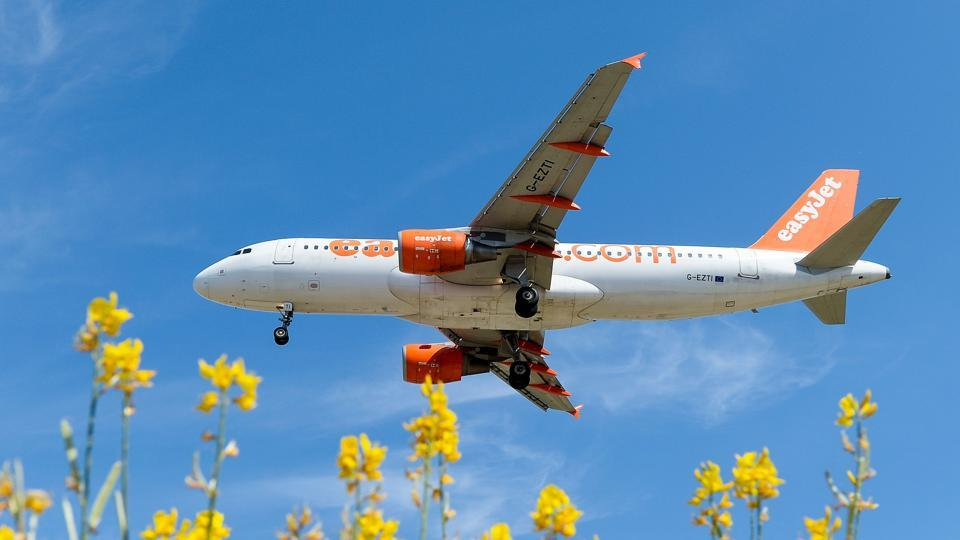 An airplane of the British lowcost airline Easyjet preparing to land at Barcelona airport.