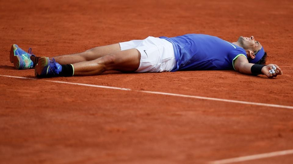 Rafael Nadal celebrates after winning the French Open final against Switzerland's Stan Wawrinka at the Roland Garros on Sunday. It was the Spaniard's record 10th title at the clay court Grand Slam in Paris.