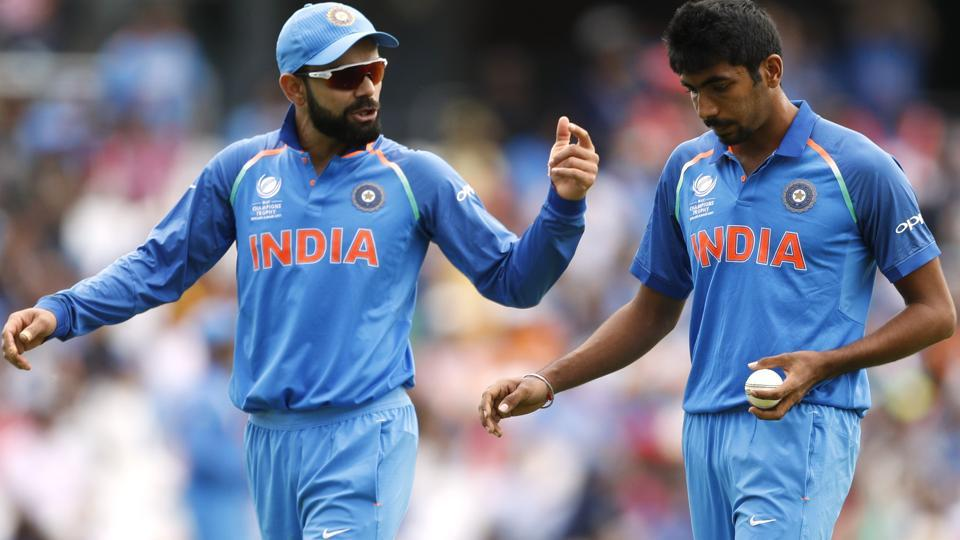 India's Virat Kohli (L) and Jasprit Bumrah during their ICC Champions Trophy match against South Africa.