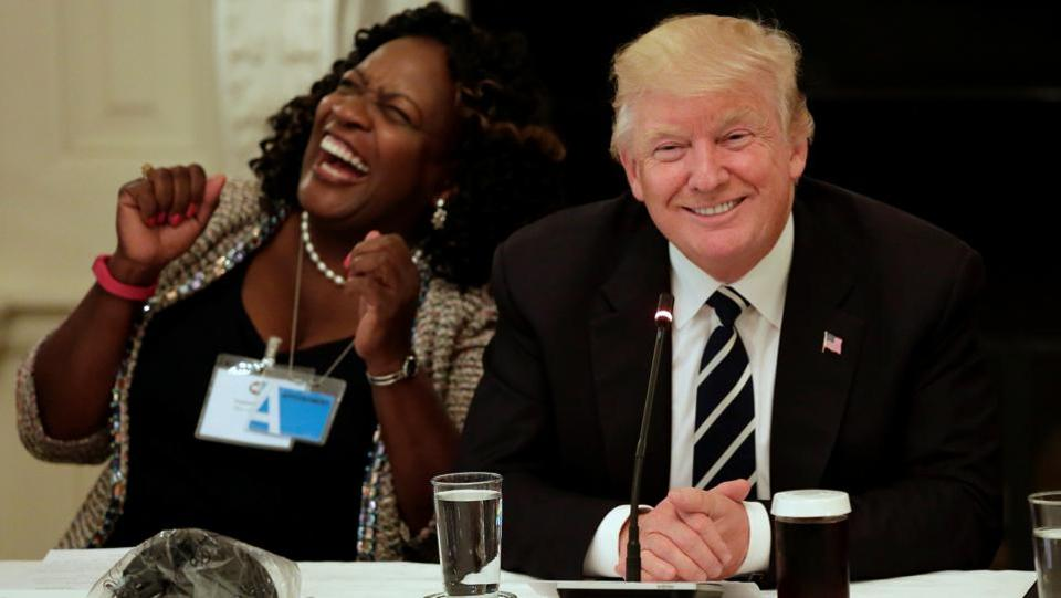 Acquanetta Warren (L), Mayor of Fontana, California, reacts after U.S. President Donald Trump introduced himself before the Infrastructure Summit with Governors and Mayors at the White House in Washington, U.S. (Yuri Gripas  / REUTERS)