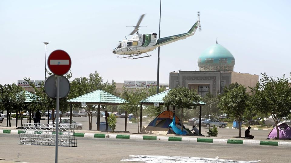 A police helicopter flies around outside the mausoleum of Ayatollah Ruhollah Khomeini in Tehran.