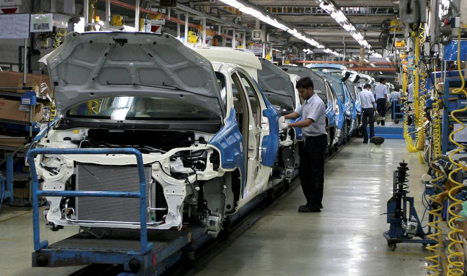 Employees work inside a plant of General Motors India Ltd. at Halol, about 150 km east from the western Indian city of Ahmedabad.