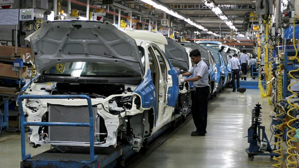Employees work inside a plant of General Motors India Ltd. at Halol, about 150 (93 miles) from Ahmedabad.