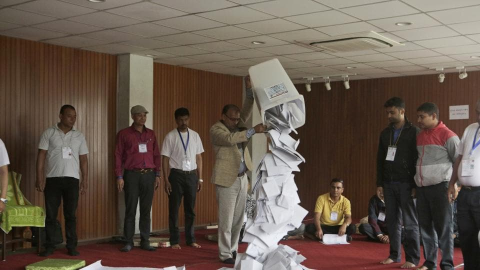 A Nepalese election commission officer empties a ballot box prior to counting the votes of local elections in Kathmandu on May 15. The second phase of the polls is scheduled on June 28.