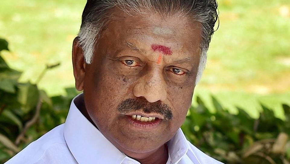 O Panneerselvam gestures as he approaches the Election Commission in New Delhi.