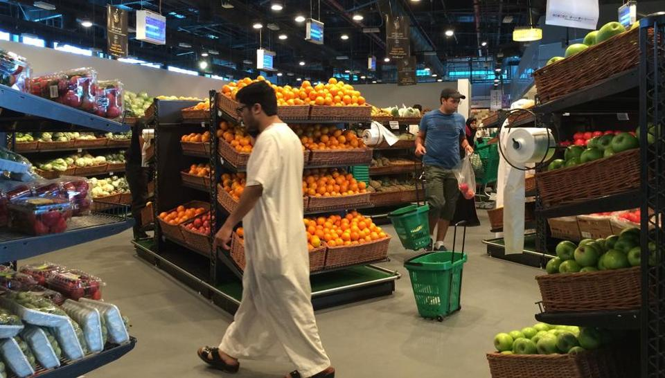 Customers are seen shopping at the al-Meera market in the Qatari capital Doha.