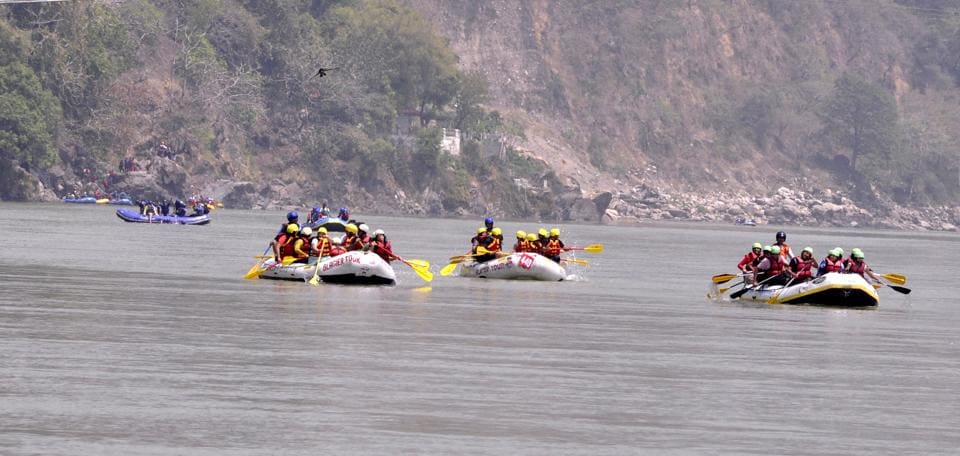 Colourful rafts are visible in the Ganga in Rishikesh.